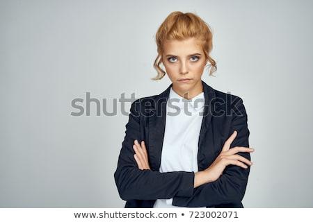 Blonde woman crossing her arms Stock photo © wavebreak_media