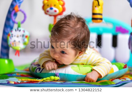 Baby on tummy Stock photo © sdenness