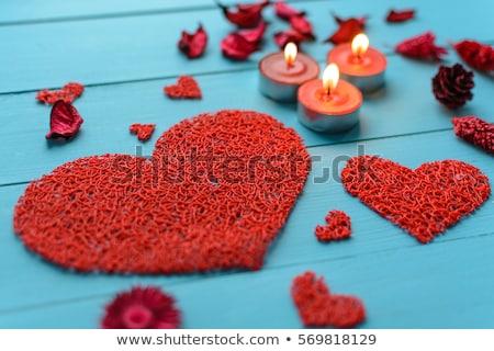 Aromatherapy on a blue board pink flowers Stock photo © lunamarina