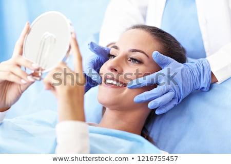 paciente · dentista · primer · plano · masculina · sonriendo · femenino - foto stock © Lighthunter