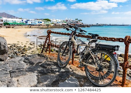 town and harbor of Playa Blanca from seaside in the evening  Stock photo © meinzahn