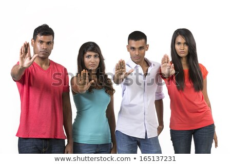 Asian young woman making stop gesture and showing stop Stock photo © bmonteny