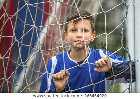 Close-up of a boy playing and smiling Stock photo © bmonteny