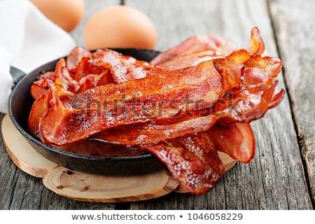 Slice of bacon on white plate Stock photo © stevanovicigor