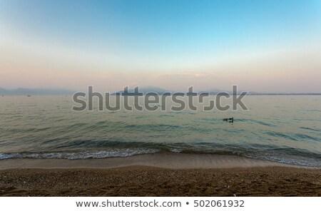 rainbow on a lake Garda with mountains as background Stock photo © master1305
