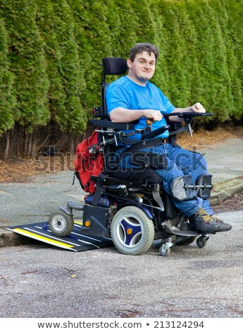 Stock photo: Disabled Man On Wheelchair Looking At Street