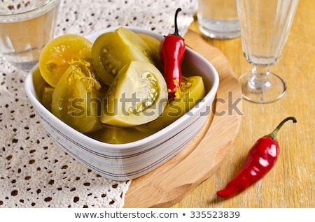Stock photo: green tomato and pepper