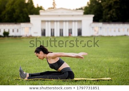 Pilates kadın bumerang egzersiz antreman spor salonu Stok fotoğraf © lunamarina