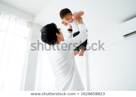Happy father playing with his son stock photo © imagedb