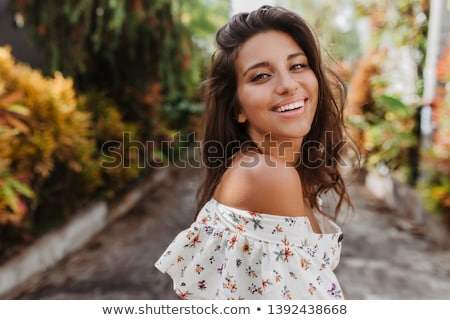 Wellness. Attractive smiling brunette girl summer portrait on ex Stock photo © Victoria_Andreas