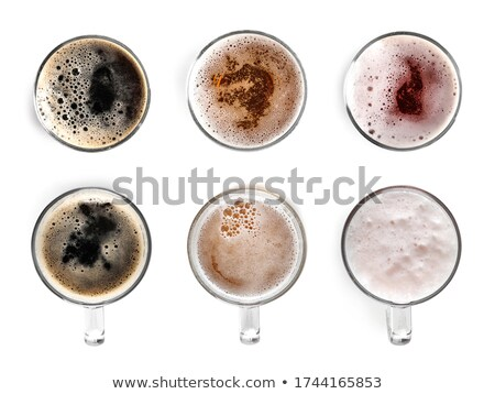 Dark beer in a beer mug on a white background Stock photo © Zerbor