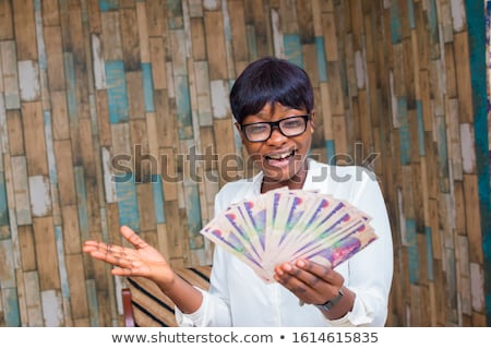young lady with money stock photo © aikon