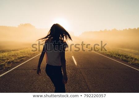 girl walking away in the park Stock photo © Giulio_Fornasar
