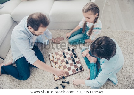 high angle view of thoughtful girl sitting by chess pieces stock photo © wavebreak_media