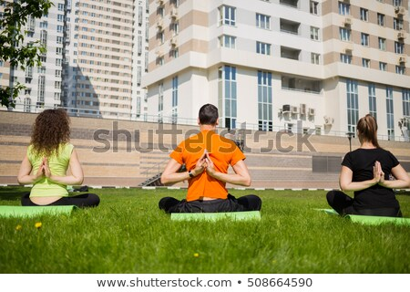Side view of girl exercising in yard Stock photo © wavebreak_media