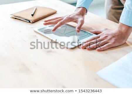 Empresário olhando tocante interface branco Foto stock © wavebreak_media