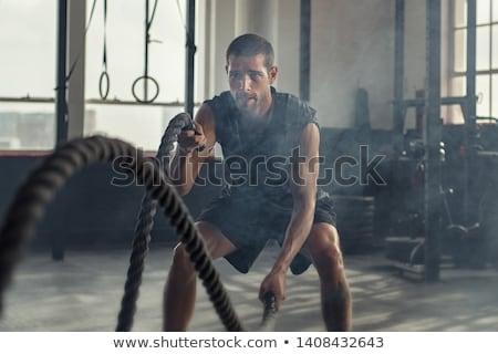 görüntü · kas · adam · kürek · çekme · makine · spor · salonu - stok fotoğraf © deandrobot