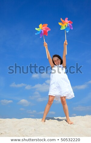 young girl with windmill on beach stock photo © is2