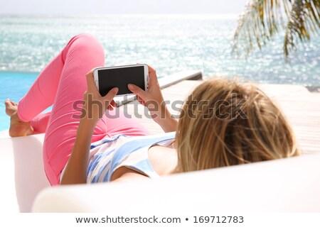 女性 デッキ 椅子 スマートフォン 屋外 ストックフォト © stevanovicigor