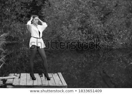 Glamorous woman holding a sandal and standing Stock photo © wavebreak_media