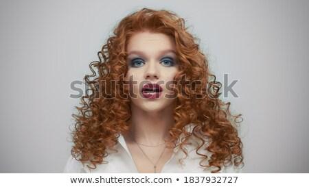 aantrekkelijk · jonge · vrouw · tonen · stilte · gebaar · rode · jurk - stockfoto © deandrobot