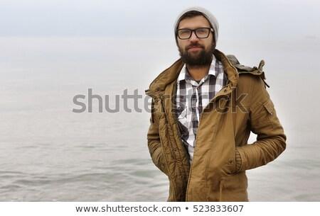 Portrait élégant barbu homme manteau posant Photo stock © deandrobot
