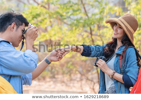Woman taking pictures of her man Stock photo © IS2