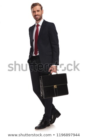 relaxed businessman in navy suit walks and looks to side Stock photo © feedough