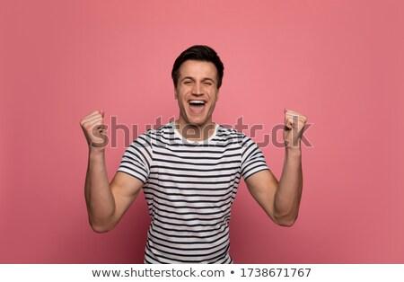 Blijde man gestreept tshirt lachend omhoog Stockfoto © deandrobot