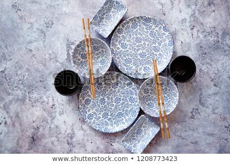 Empty oriental style dishware set on gray stone background Stock photo © dash