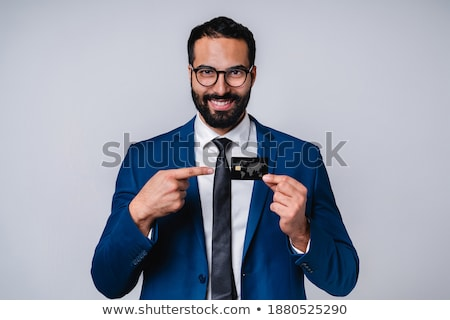 Image of successful businessman 30s in formal suit pointing fing Stock photo © deandrobot