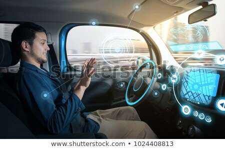 Relaxed man driving by smart car Stock photo © jossdiim
