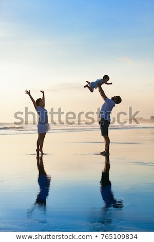 Father and son have fun in the tropics Stock photo © galitskaya