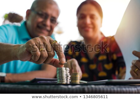 Couple Stacking Coins In A Row Stock photo © AndreyPopov