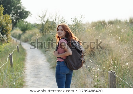 woman with backpack and camera over beach stock photo © dolgachov
