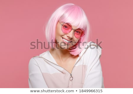 Image of pretty woman 20s wearing sweatshirt smiling, isolated o Stock photo © deandrobot
