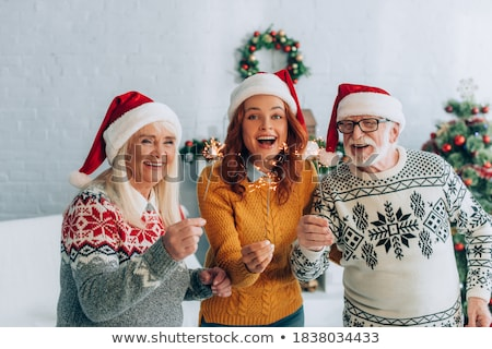 ストックフォト: Happy Senior Couple In Santa Hats At Christmas