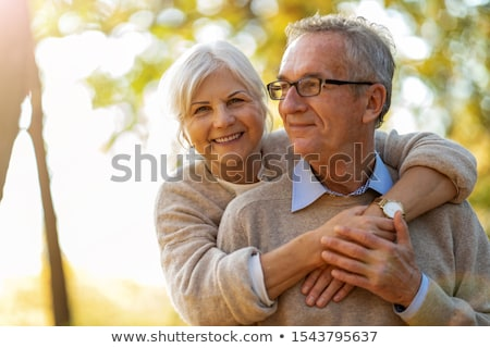 happy elderly couple hugging Stock photo © Kurhan