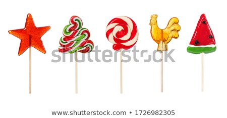Green lollipop on white background Stock photo © magraphics