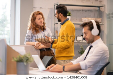 Positive colleagues discussing plan of project implementation Stock photo © pressmaster