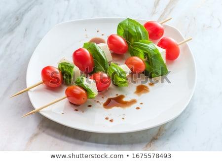 Friss klasszikus caprese saláta koktélparadicsom mozzarella bazsalikom Stock fotó © karandaev