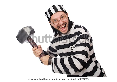 The prison inmate with hammer isolated on white Stock photo © Elnur