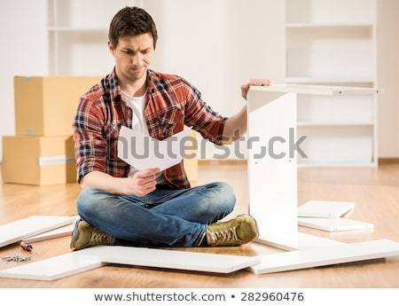 the young man repairing furniture at home stock photo © elnur