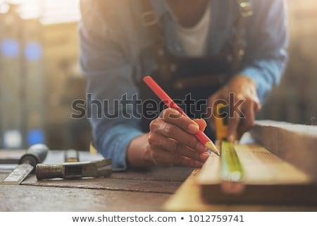 Woodworker man at workplace Stock photo © jossdiim
