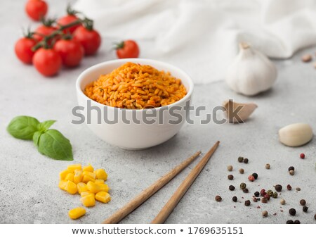 White ceramic bowl plate with boiled red long grain basmati rice with vegetables on light table back Stock photo © DenisMArt