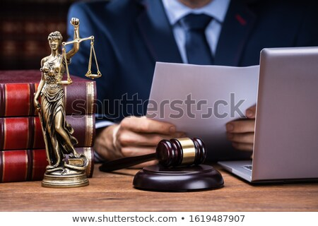 Lawyer Reading Documents Near Mallet And Laptop Stock photo © AndreyPopov