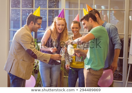 Birthday party for the young female colleague in the office with Stock photo © boggy