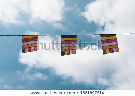 Buddhist flags at a temple in Vietnam Stock photo © galitskaya