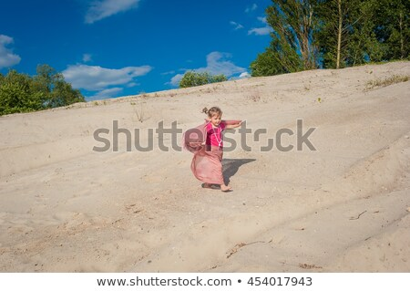 Young girl runs on sand in yellow shawl Stock photo © Paha_L