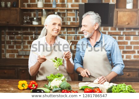 Woman tossing a salad Stock photo © photography33